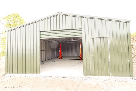 Shed with car lift